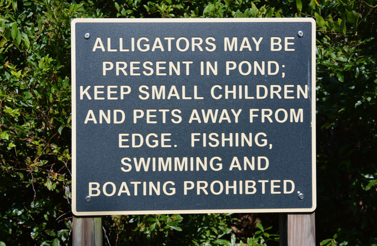 A warning sign at Halyburton Park in Wilmington, NC