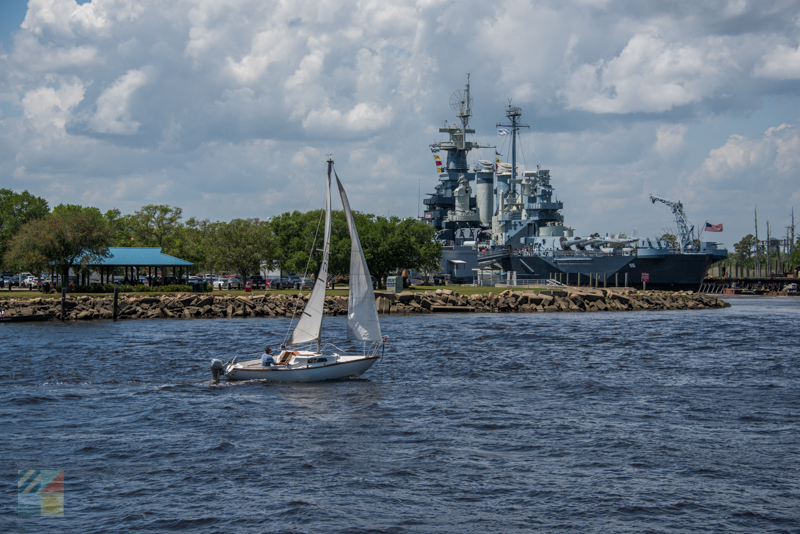 Sailing in front of the USS North Carolina and downtown Wilmington